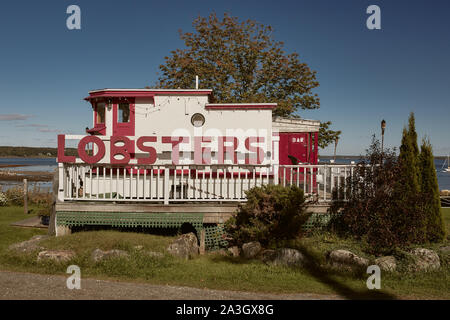 Lincolnville, Maine - September 27th, 2019:  Red and white wooden lobster shack on Lincolnville Beach off the coast of Penobscot Bay in Lincolnville - Stock Photo