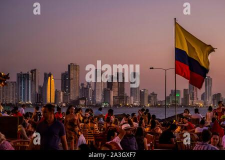 Colombia, Bolivar Department, Cartagena of the Indies, colonial center registered World Heritage bu UNESCO, Caf? del Mar on the fortified wall that surrounds the historic center, with sea front and buildings of Boca Grande in the back - Stock Photo