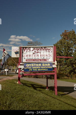 Lincolnville, Maine - September 27th 2019: Wooden sign for McLaughlins Lobster Shack off of Route 1 in Lincolnville, Maine. - Stock Photo