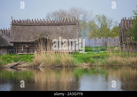 Old wooden viking huts in a village . - Stock Photo