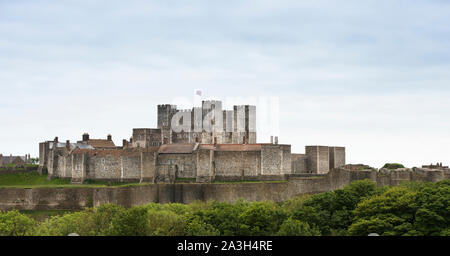 Dover Castle,postcard view, Union Jack flying from keep. British Heritage. Blue sky. Copy space. Curtain perimeter walls and surrounding greenery.