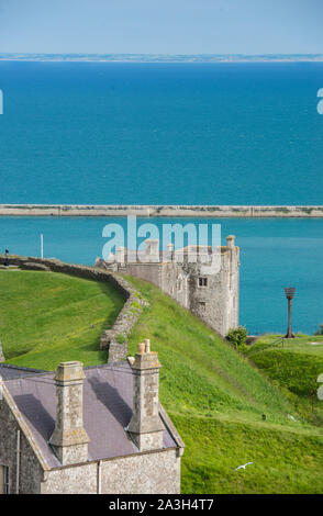 View of the Admiralty Pier and the English Channel seen from the ramparts of Dover Castle, Southeast England, bit bits of St. Mary of Castro church. - Stock Photo