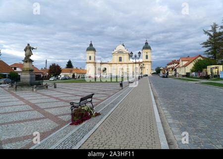Tykocin / Tiktin,  Market Square with Stefan Czarniecki monument and Holy Trinity Church, Podlasie region, Poland - Stock Photo