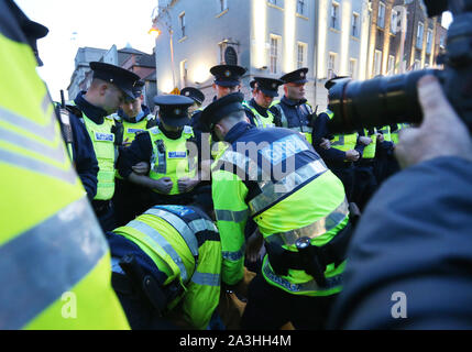 08/10/2019 Budget Day 2020 protests. Pictured, members of An Garda Siochana begin to arrest members of Extinction Rebellion who are protesting outside the Dail on Leinster Street. Photograph: Sam Boal / RollingNews.ie - Stock Photo