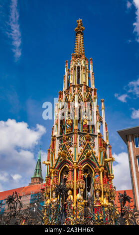 Gothic Schoner Brunnen (beautiful fountain) at the Hauptmarkt (main market) square in Nurnberg Old Town, Bavaria, Germany, one of the main tourist att - Stock Photo