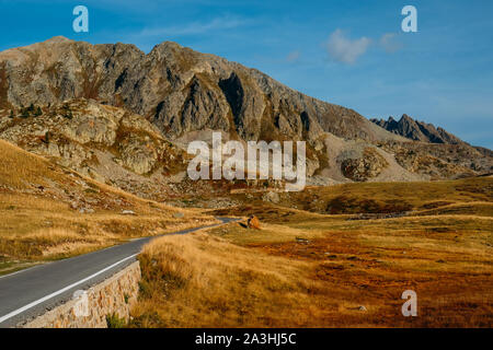 Road in the mountains. Beautiful view of Col de la Lombarde or Colle della Lombarda in the Alps - Stock Photo