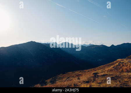 Beautiful alpine landscape with mountain silhouettes in the Col de la Lombarde during the sunset - Stock Photo