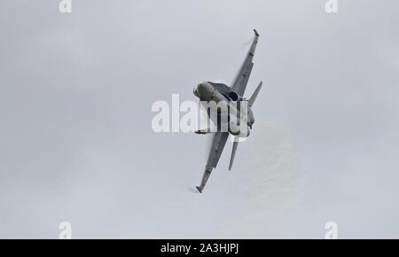 Swiss Air Force F/A-18C Hornet performing at the 2019 Royal International Air Tattoo - Stock Photo