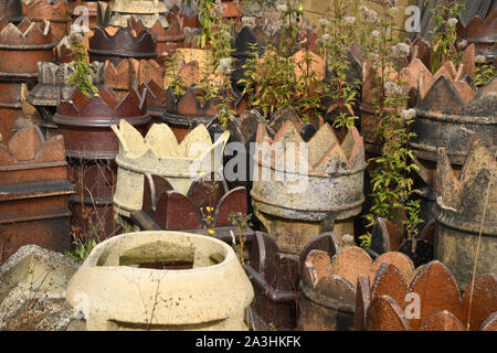 Interesting Victorian chimney pots  in an English west country architectural salvage yard. - Stock Photo
