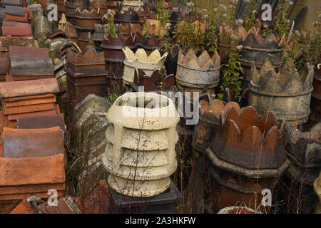 Interesting Victorian chimney pots and ridge tiles in an English west country architectural salvage yard. - Stock Photo
