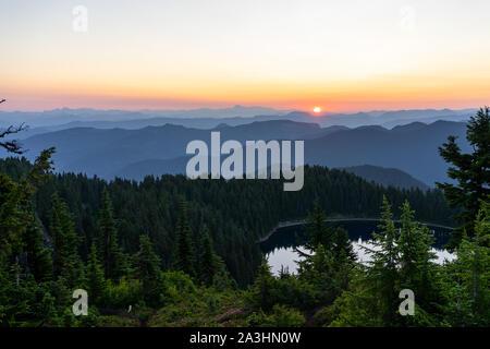 Orange sunrise over Summit Lake on summer day in Washington