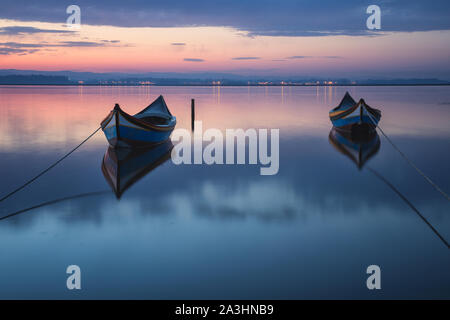Two wooden boats at Sunrise - Stock Photo