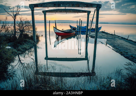 wooden traditional portuguese boats at sunrise - Stock Photo