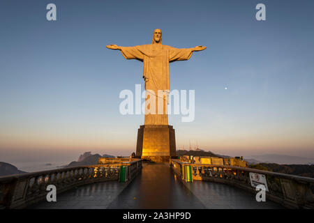 View to Christ the Redeemer Statue during sunrise up on Corcovado Mountain, Rio de Janeiro, Brazil - Stock Photo