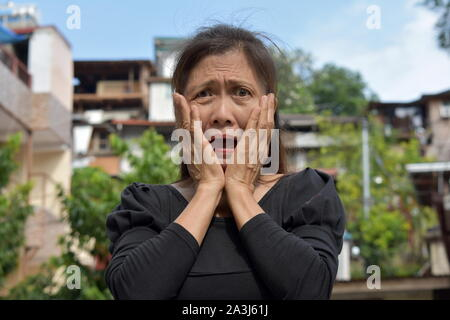 A Shocked Female Senior Gramma - Stock Photo