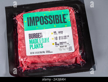 MORGANTOWN, WV - 8 October 2019: Packaging for Impossible Foods burger made from plants on steel background - Stock Photo