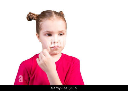 The girl tears off adhesive tape pasted on her mouth. Isolated on a white background. - Stock Photo