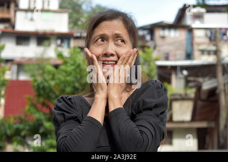 A Surprised Asian Person