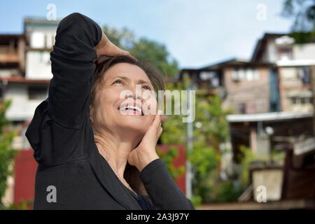 An Asian Female Senior Wondering