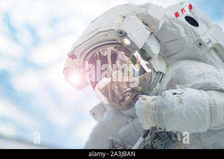 Astronaut in outer space in a spacesuit. Elements of this image were furnished by NASA. - Stock Photo
