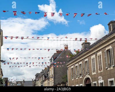Allied flags flying over Normandy villages celebrating the 75th anniversary of the Normandy invasion. - Stock Photo