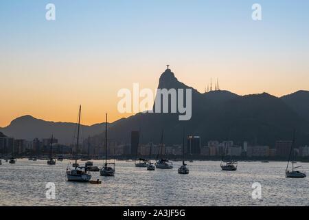 Rio de Janeiro, Brazil - October 3, 2019: beautiful sunset of Rio de Janeiro, with clear sky, mountain skyline, seen from the Mureta da Urca - Stock Photo