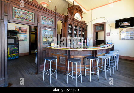 View of the bar and its stained glass at the old historic Imperial Hotel in the small rural town of Ravenswood, Queensland, QLD, Australia - Stock Photo