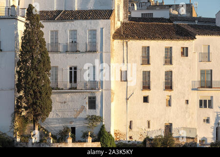 The white houses of the town of Ronda at sunset, Andalusia, Spain - Stock Photo