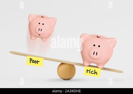 oor and rich piggy bank on balance scale - Concept of social inequality between rich and poor