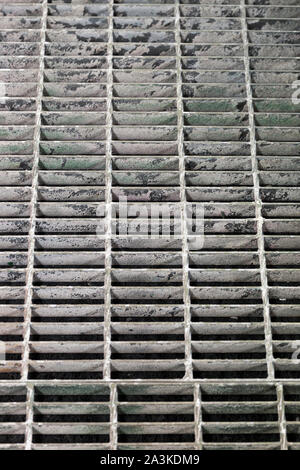 Metal grate inside spray booth for excess paint runoff. - Stock Photo