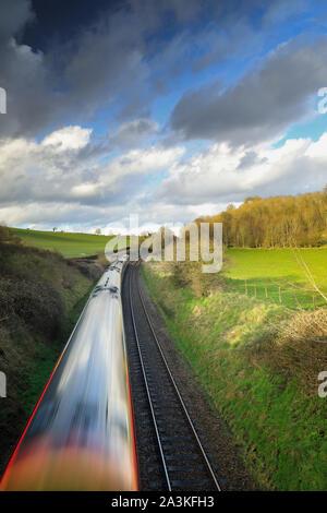 the Exeter to London Waterloo train passing near Milborne Port, Somerset, England, UK - Stock Photo