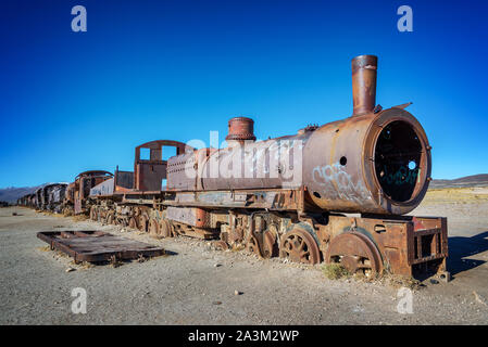 Old rusty locomotive abandoned in the train cemetery of Uyuni, Bolivia - Stock Photo