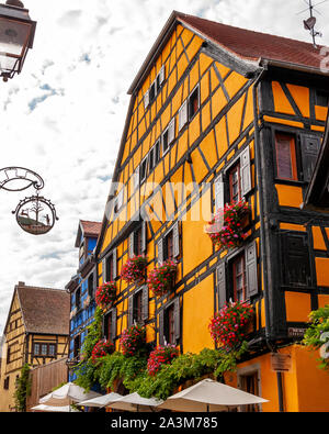 Riquewihr in Alsace, France. Enchanting medieval village, along the wine road that connects Colmar to Strasbourg. View of the old village within the w - Stock Photo