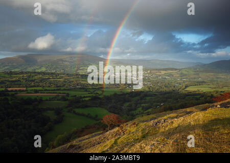 Rainbows over Crickhowell with the Black Mountains in the distance. Brecon Beacons National Park. Powys. Wales. UK. October 2019 - Stock Photo