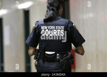 New York, United States. 09th Oct, 2019. An officer of the New York State Courts walks in the hallway before former Donald Trump campaign manager Paul Manafort has a status hearing for the New York state fraud charges against him on Wednesday, October 9, 2019 in New York City. Manafort is already serving a seven-and-a-half year federal prison sentence stemming from the special counsel probe of Russian election meddling in 2016. Photo by John Angelillo/UPI Credit: UPI/Alamy Live News - Stock Photo