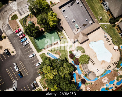 Neighborhood pool, mini-golf, basketball and playground from above - Stock Photo
