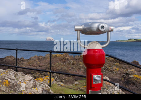 A coin operated telescope at North Berwick on the East Lothian Coast looking out towards The Bass Rock in the Firth of Forth - Stock Photo