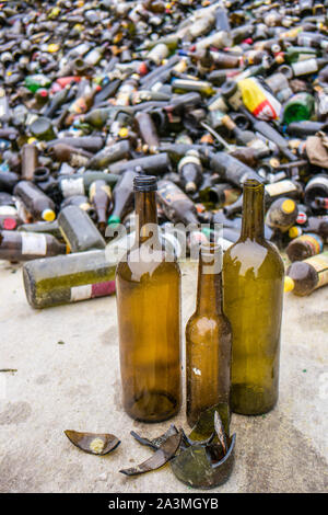 Brown glass bottles recycling yard - Stock Photo