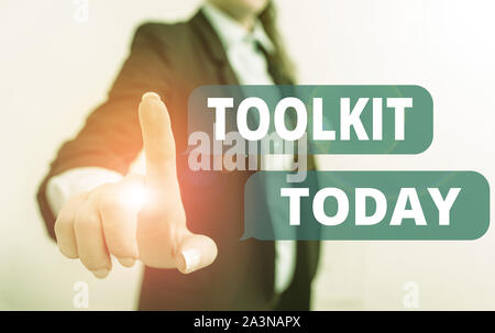 Text sign showing Toolkit. Business photo text set of tools kept in a bag or box and used for a particular purpose Digital business in black suite con - Stock Photo