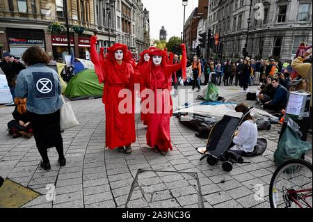 Red Brigade Performance Group, Extinction Rebellion Protest, Day Three, Trafalgar Square, London. UK