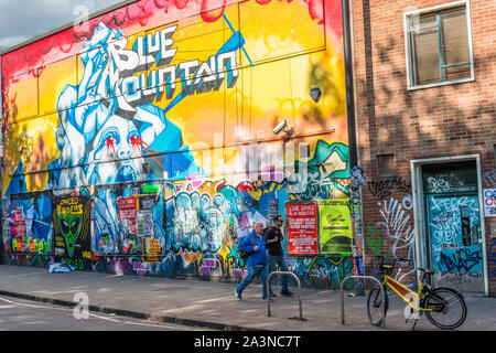 Blue Mountain mural at Stokes Croft, a colourful district of Bristol full of street art. Avon. England. UK. - Stock Photo