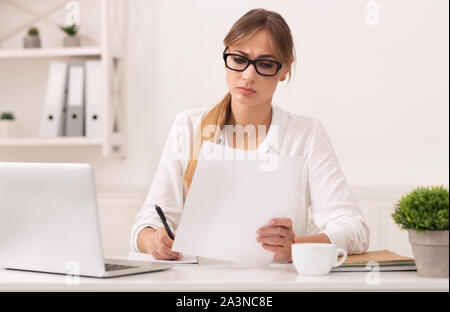 Serious Business Lady Reading Report Taking Notes In Modern Office - Stock Photo