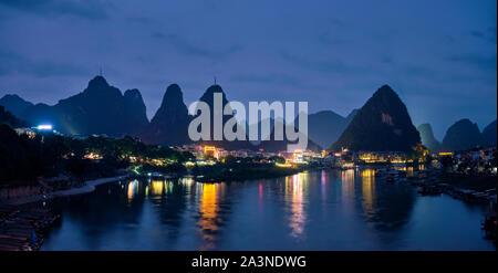Yangshuo town illuminated in the evening, China - Stock Photo