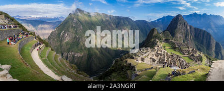 Amazing panoramic view of Machu Picchu ruins in Peru. Behind we can appreciate big and beautiful mountains full of green vegetation. Archaeological si - Stock Photo