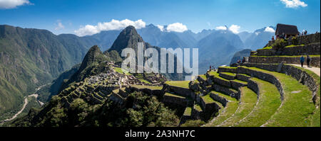 Panoramic view of Machu Picchu ruins in Peru. Behind we can appreciate big and beautiful mountains full of green vegetation. Archaeological site, UNES - Stock Photo