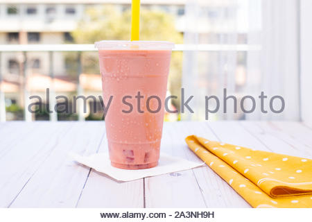 Strawberry bubble milk tea on the wood table - Stock Photo