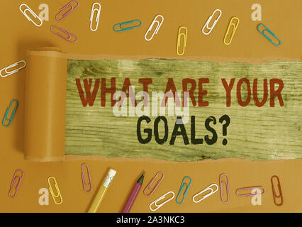 Conceptual hand writing showing What Are Your Goals Question. Concept meaning ask the Desired End Results to know the plans - Stock Photo