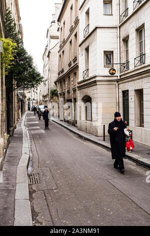 People walking on the street. Paris, France. - Stock Photo