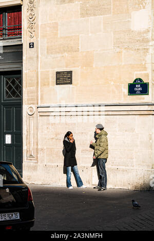 A couple talking outside the Law School of Sorbonne University. Paris, France. - Stock Photo