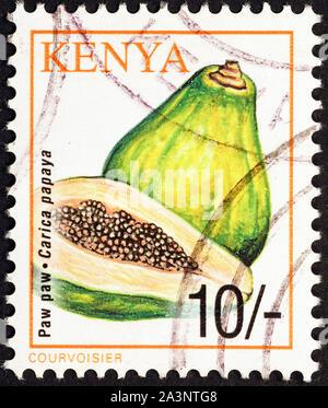 Papaya fruit on postage stamp of Kenya - Stock Photo